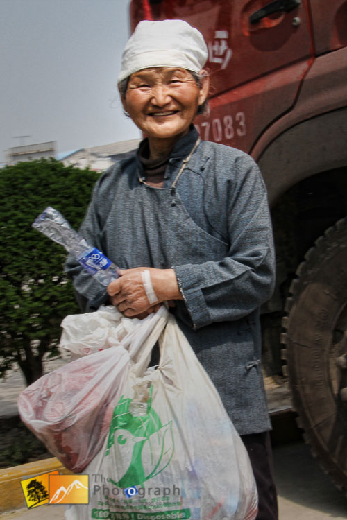 old lady collecting rubbish