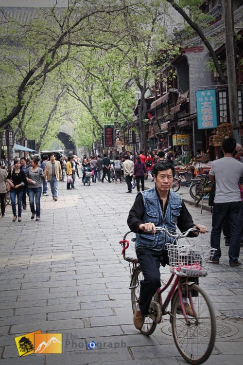 riding a bike in the muslim market of Xian