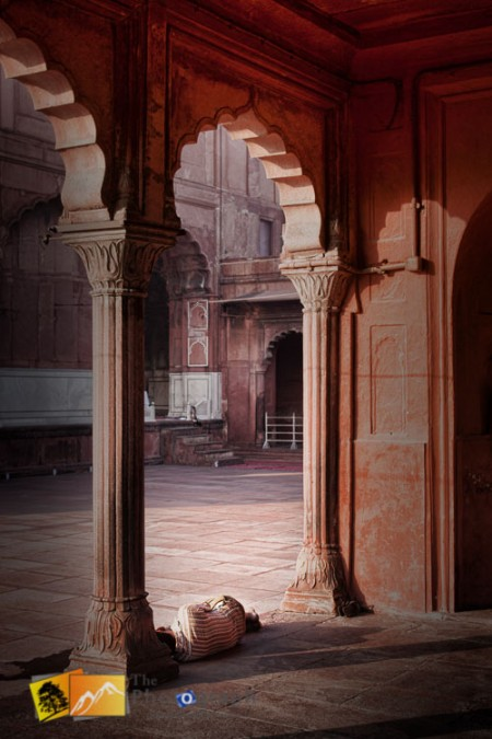 Man asleep at Jama Masjid Mosque