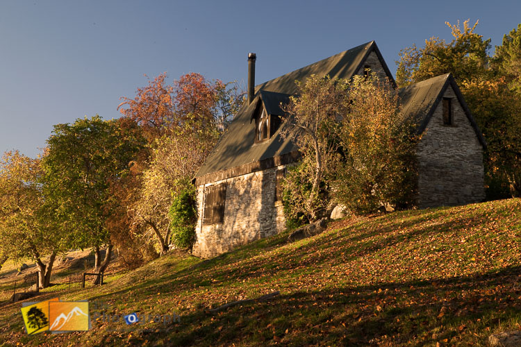 Hays lake cottage surrounded by Autumn leaves.