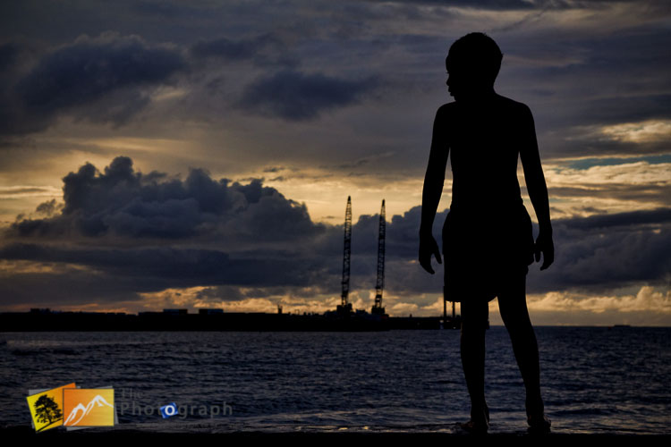 kids on the sea front at sunset